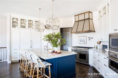 white kitchen  satin nickel knobs  navy center