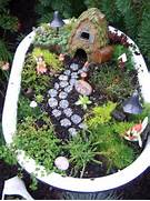 Larger Fairy Garden Can Fit In A Baby Bathtub You Can Put It Out In Natural Fairy Garden Ideas Miniature November 2010 The Mini Garden Guru Your Miniature Garden Source Beautiful Fairy Garden Design With A Miniature House And A Garden Path