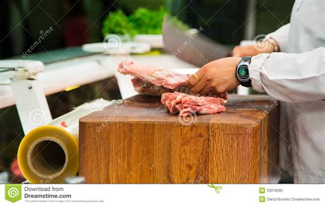 Butcher Cutting Meat With Cleaver Stock Image Image