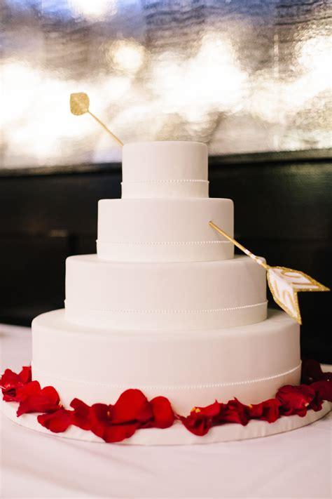 white cupids arrow wedding cake