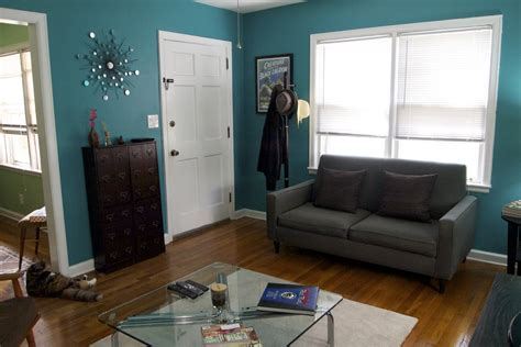 brown and teal living room decor well hello there design in my home house tour part 1