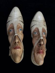 foot faces in discarded shoes