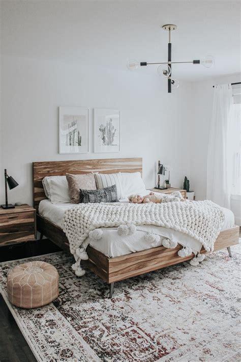 neutral bedroom design  extra large rug  wood bed
