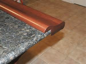 top of kitchen cabinet decorating ideas chicago bar rail fastened to granite