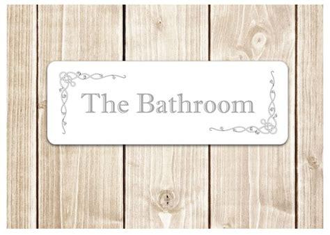 the bathroom door sign metal plaque for toilet or