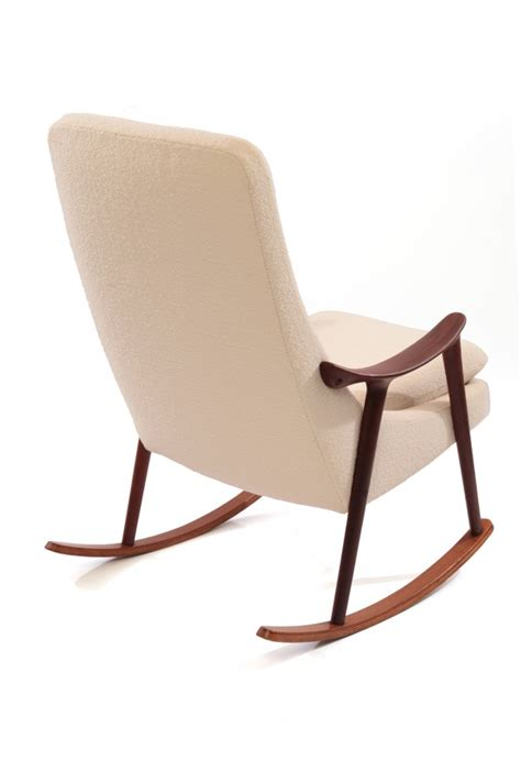 sculptural teak upholstered rocking chair
