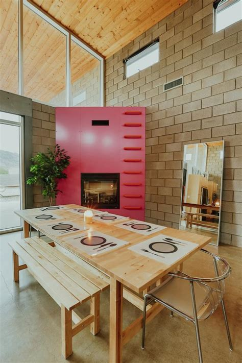bright pink fireplace  industrial modern dining room hgtv