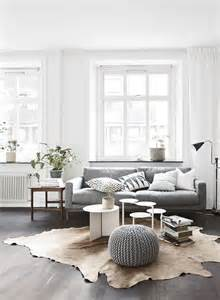 livingroom sofas living room white walls white window frames light grey sofa timber floorboards grey