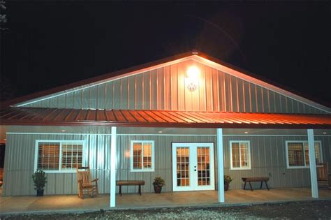 wrap around porch home plans impressive metal barndominium home w abundant storage 24