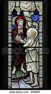 Stained glass window of the baptism of Jesus by John the ...
