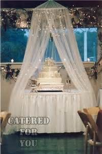 lighted tulle canopy  cake awesome wedding event