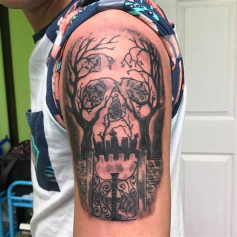 impressive graveyard  cemetery tattoo designs