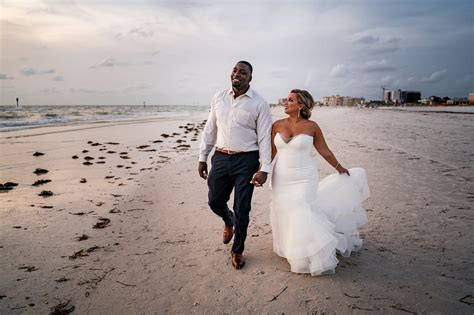 Tampa Bay Bride and Groom Take Sunset Stroll on Clearwater