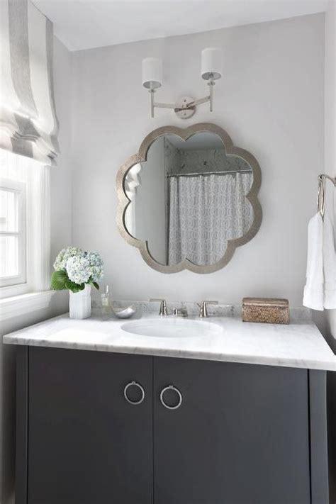 gray mirror  white sink vanity cottage bathroom