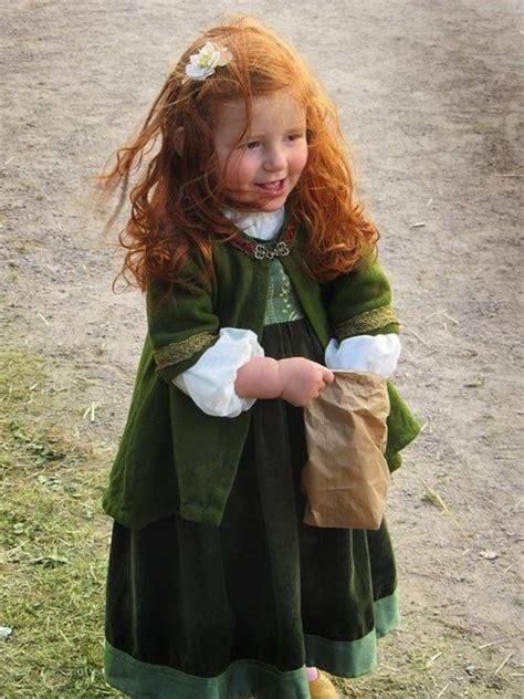 Cute Redhead In Celtic Green Feeds The Birds Kristi