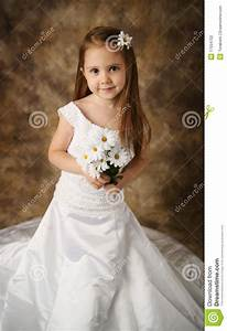 little girl trying on mommy39s wedding dress stock photo With young girls wedding dresses