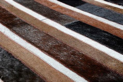 brown and white rug patch cowhide rug in plain black brown and white stripes