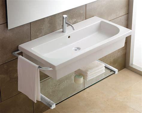 wall hung bathroom sink bahtroom big window near simple mirror on calm wall tile
