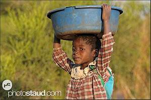 Zambian child carrying laundry on head, Zambia | Zambia ...