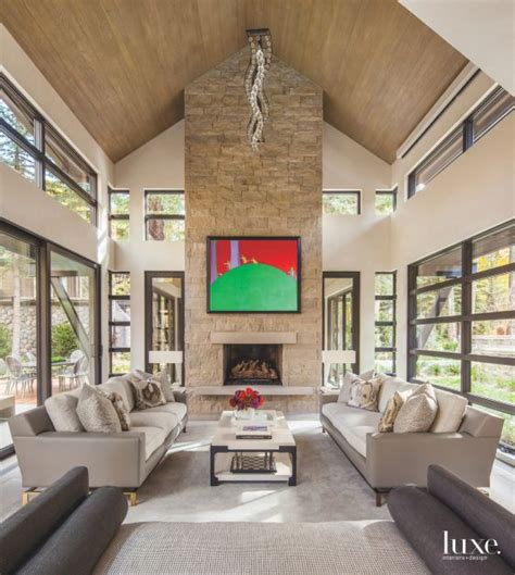 high vaulted ceiling living room  stone fireplace