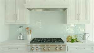 kitchen backsplash with white cabinets white kitchen cabinets with blue glass tile backsplash transitional kitchen