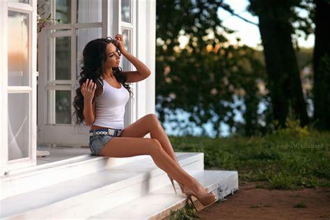 women   sitting brunette jean shorts high