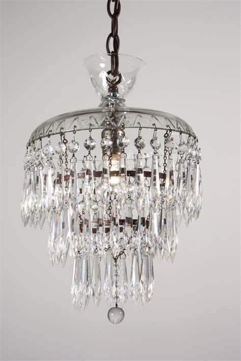 antique three tier chandelier with glass
