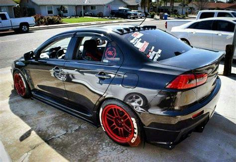 Black Mitsubishi Evo by Stanced Black Mitsubishi Evo X Evo Evo X Jdm Cars