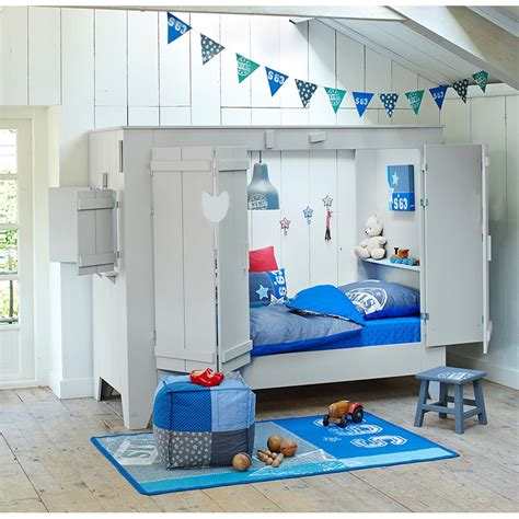 Cupboard For Children by Cupboard Style Cabin Bed In White With Folding Doors