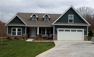 dark green siding exterior traditional with three panel