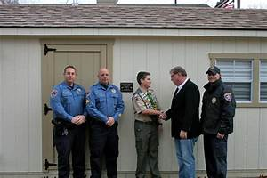 Sheriff Joe Cryan congratulates Eagle Scout Brendan ...