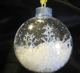 christmas ornament idea clear glass ball fill half with quot snow quot paint snowflakes trees with