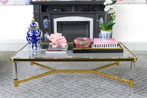 This particular coffee table is a very popular choice for the people because of its amazing metal design that will go great with the stylish look of the living room. 5 Chic & Glam Coffee Table Decor Ideas - Monica Wants It