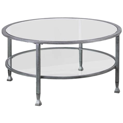 Each showcasing painted, metal legs and a round, tempered safety glass table top. Southern Enterprises Jaymes Round Glass Top Coffee Table in Silver - CK0740