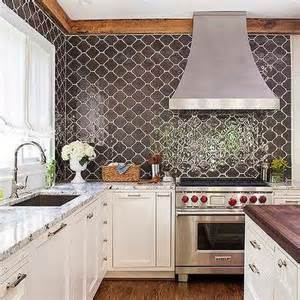 moroccan tiles kitchen backsplash brown granite countertops transitional kitchen