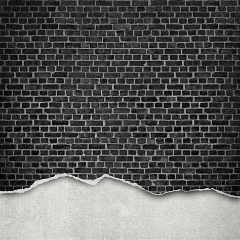 worn brick wall black  rebel walls