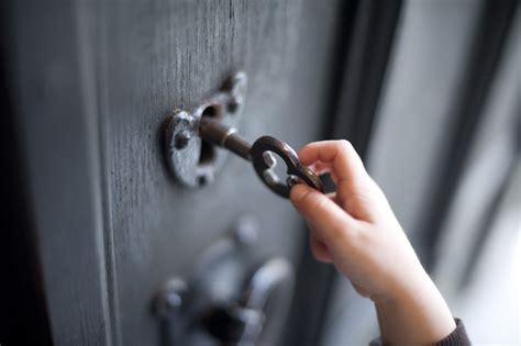 unlock the door boy unlocking a door 7249 stockarch free stock photos