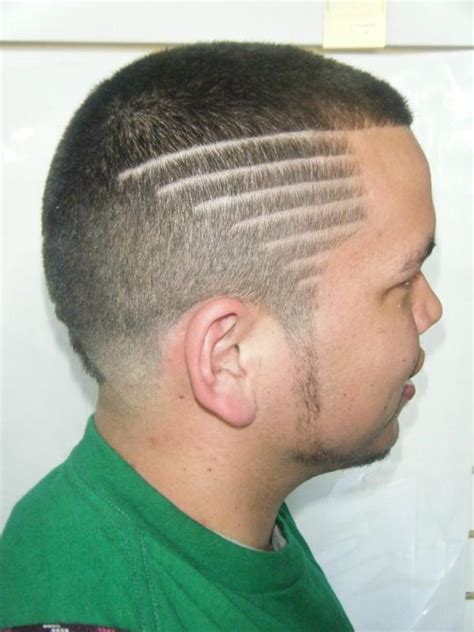 taper fade haircut with designs 5 brave taper haircut styles harvardsol 3451