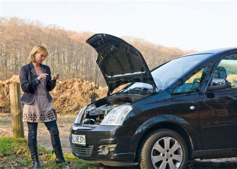 woman  car problem calls   stock photo
