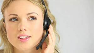 Woman Using A Headset To Talk To A Customer Against A