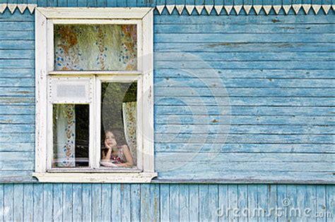 sad bored  girl    country house window