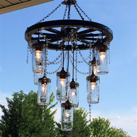 wagon wheel chandelier with 3 tiers of jar lights