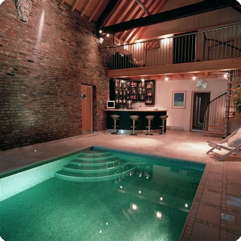 Appealing Indoor Pool Design With Green Water Shade And