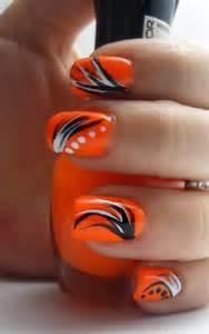 Stylish orange and black nail art design ideas