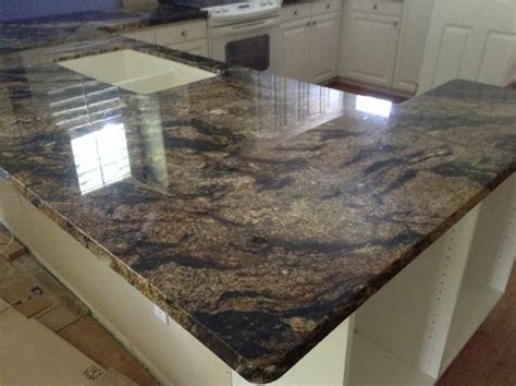 backsplash ideas for magma gold counters white cabinets