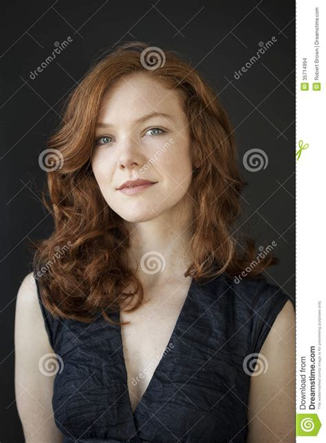 Young Woman With Beautiful Blue Eyes And Red Hair Stock