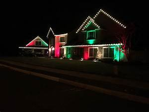 Holiday decorating lighting in wall township brick