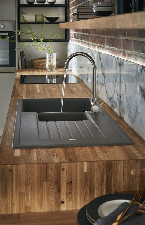 Our black granite composite sink contrasts beautifully in