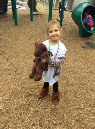 preschool amp daycare in temple the peanut gallery 674 | preschool girl holding teddy bear on playground at the peanut gallery temple tx 333x450
