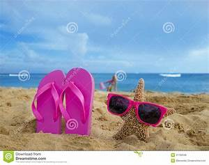 Girl's Flip Flops And Starfish With Sunglasses On Sandy ...